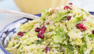 Shaved Brussels Sprouts with Bacon, Leeks, and Pomegranante seeds